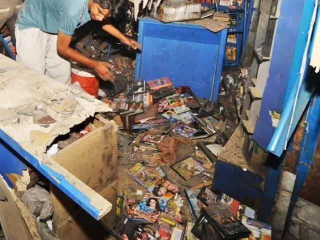 A file photo of a CD shop damaged in a blast in Lahore. PHOTO: EXPRESS