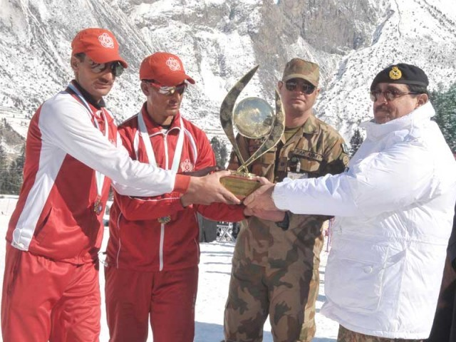 The inter-services championship winner Abbas (second left) was hailed as the fastest athlete in the country in the giant Slalom events. PHOTO: SKI FEDERATION OF PAKISTAN