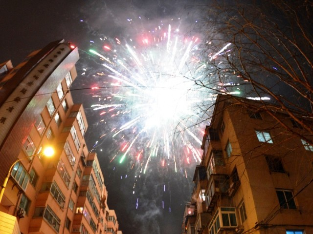 Revellers across the city lit fireworks and prayed as China traditionally welcomed in the New Year. PHOTO: AFP