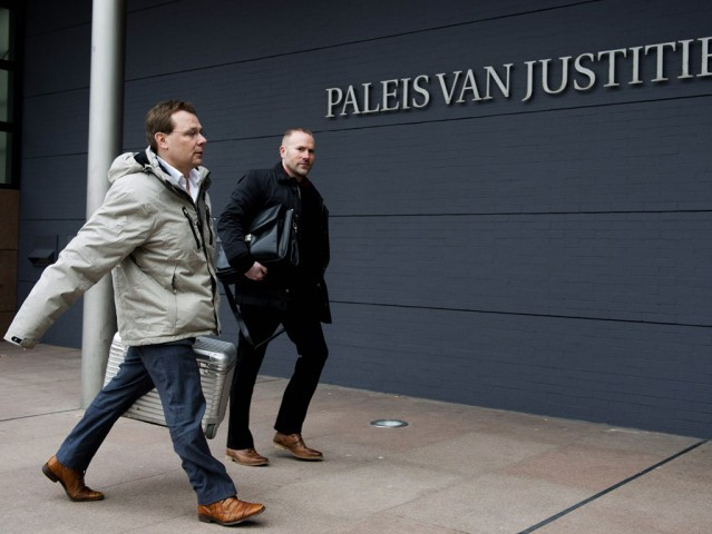 Lawyer of Pakistani-Dutch national Sabir Khan, Andre Seebregts (L), arrives in the courtroom of The Hague, on February 12, 2013.  PHOTO: AFP