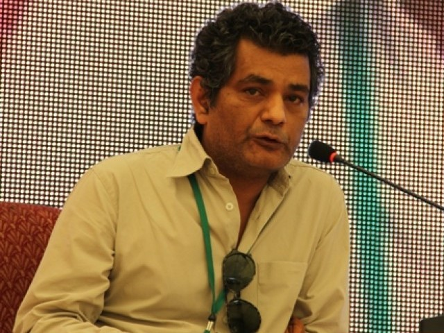 Writer Mohammed Hanif during his session on day two of the Karachi Literature Festival 2013. PHOTO: EXPRESS