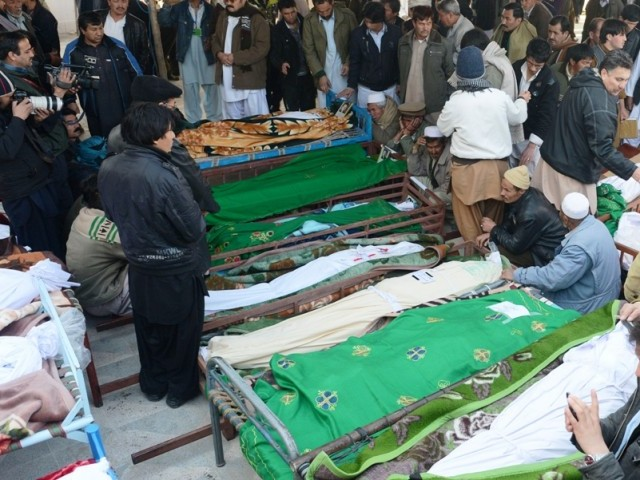 Families mourn the death of relatives as they gather with coffins of bomb attack victims during a protest in Quetta. PHOTO: AFP