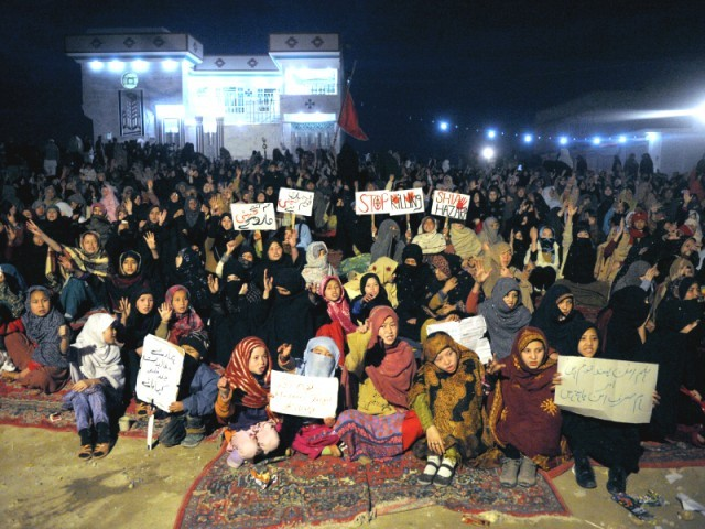 A large number of Hazaras gather during a sit-in in Quetta against Saturday's brutalities. PHOTO: AFP