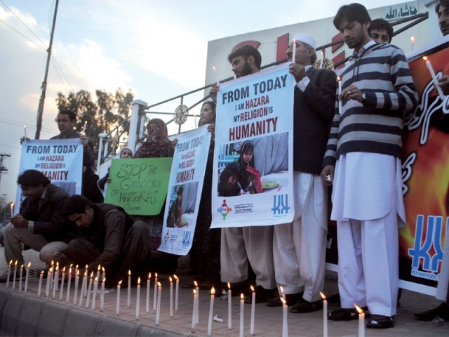 Activists of Pakhtunkhwa Civil Society Network hold a candlelight vigil at the Peshawar Press Club. PHOTO: MUHAMMAD IQBAL/EXPRESS