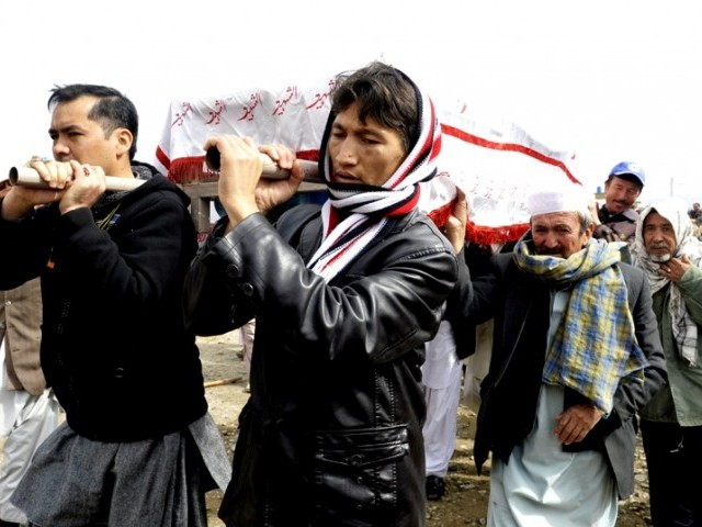 Pakistani Shia Muslims carry the coffins of relatives during a mass burial ceremony  in Quetta on February 20, 2013. PHOTO: AFP