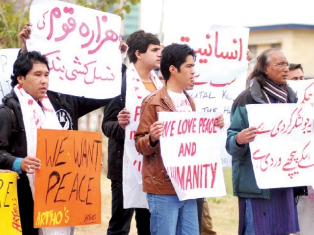Activists holding placards during a protest over Hazara killings, in Islamabad on Thursday. PHOTO: ONLINE