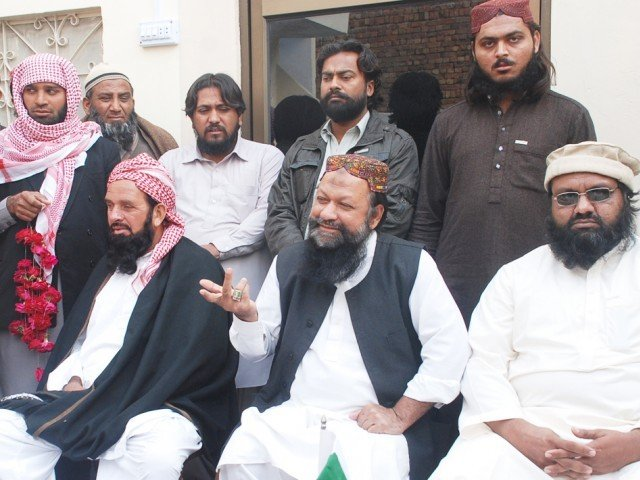 A photo of Malik Ishaq addressing a press conference on February 22