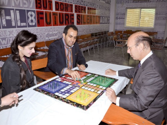Spanish Ambassador Carbajosa playing  a game of Ludo against RMS CEO Faisal Mushtaq. PHOTO: MUHAMMAD JAVAID/ EXPRESS