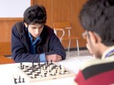 Two boys focusing on their chess match . PHOTO: MYRA IQBAL/ EXPRESS