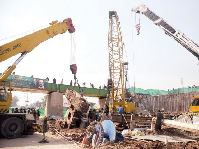 Experts have been called from Karachi and Lahore to assist city officials at the site. PHOTO: WASEEM IMRAN/EXPRESS