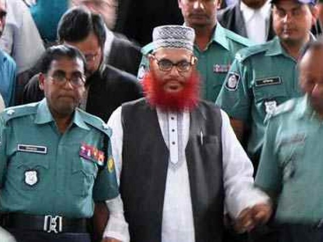 Jamaat-e-Islami leader Delwar Hossain Sayedee (C) emerges from the Bangladesh International Crimes Tribunal in Dhaka on August 10, 2011. PHOTO: AFP