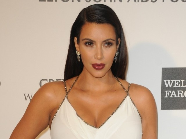 Kim Kardashian arrives for the 21st Annual Elton John AIDS Foundation's Oscar Viewing Party February 24, 2013 in Hollywood, California. PHOTO: AFP