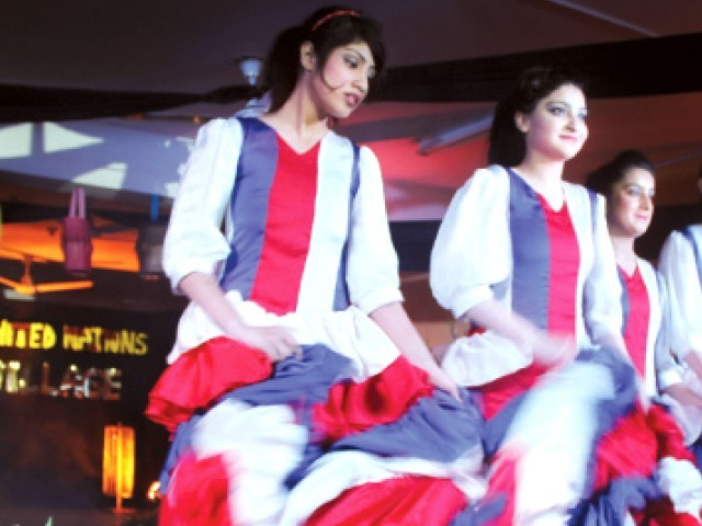 Girls dance to French music at the cultural show. PHOTO: WAQAS NAEEM/EXPRESS
