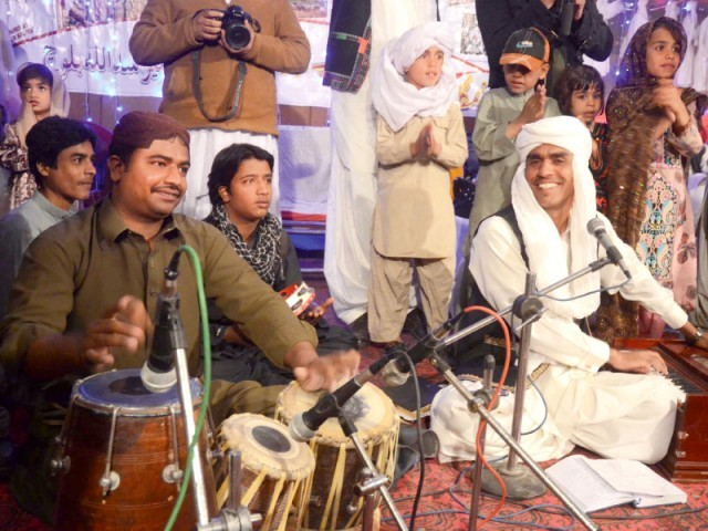 Musicians perform during a ceremony to mark the Baloch Culture Day in Quetta on Saturday. PHOTO: PPI