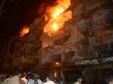 Pakistani residents gather after the bomb blast in Karachi on March 3, 2013. PHOTO: AFP