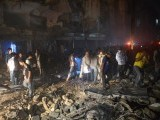 Pakistani rescuers work at the site of the bomb blast in Karachi on March 3, 2013. PHOTO: AFP