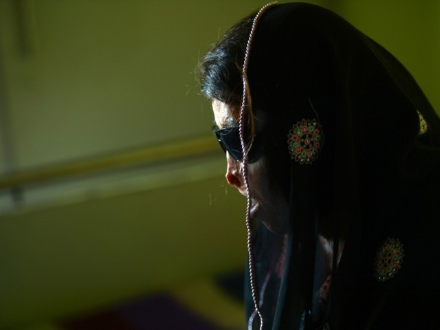 An acid attack victim waits for eye surgery at a hospital in Rawalpindi. PHOTO: AFP