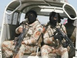 Rangers in Karachi carrying out an operation in the city today. PHOTO: EXPRESS