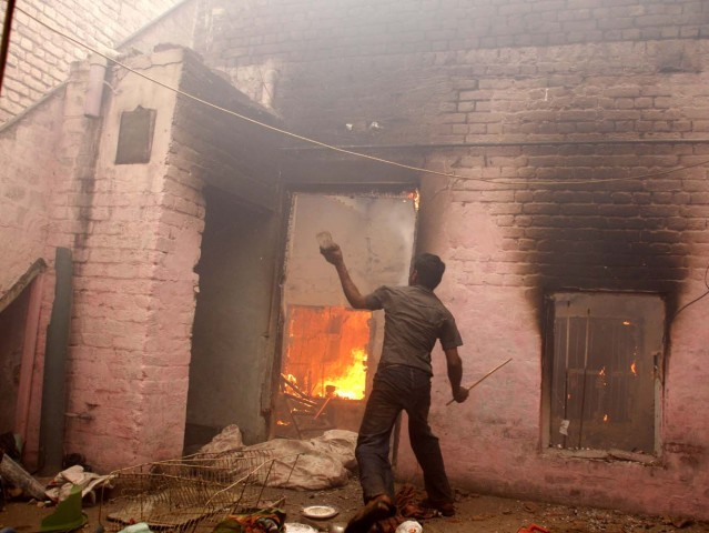 A highly-charged mob of thousands burnt more than 40 Christian houses in Badami Bagh area of Lahore on Saturday. PHOTO: ABID NAWAZ/ EXPRESS