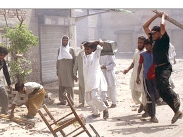 Rioters in Gojra ran amok over rumours of desecration of the Holy Quran. PHOTO: EXPRESS/FILE