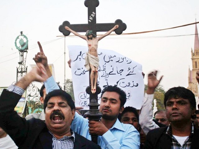 Members of the Christian community stage a protest against the Badami Bagh incident in Karachi on Saturday. PHOTO: ONLINE