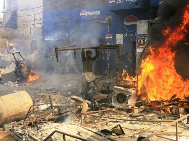 An angry demonstrator burns furniture during a protest in the Badami Bagh area of Lahore March 9, 2013.