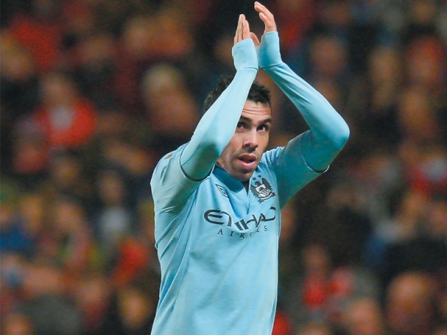Tevez was in inspiring form as City brushed aside Barnsley to book a place in the semi-final. PHOTO: AFP