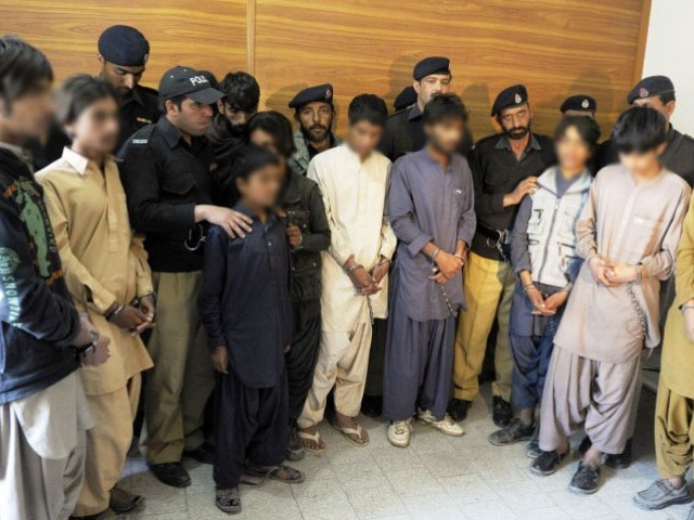 Pakistani police produce young children, suspected of planting bombs, to the media in Quetta on March 13, 2013. PHOTO: AFP