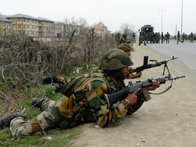 Indian soldiers take positions outside a school after an attack against Indian paramilitary personnel in Srinagar on March 13, 2013. PHOTO: AFP