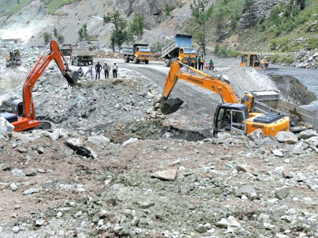 Excavators dig up earth at the site of Kishanganga power project north of Srinagar. PHOTO: FILE