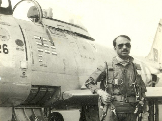 This undated photograph released by the Pakistan Air Force shows MM Alam standing next to his F-86 Sabre. PHOTO: PAF