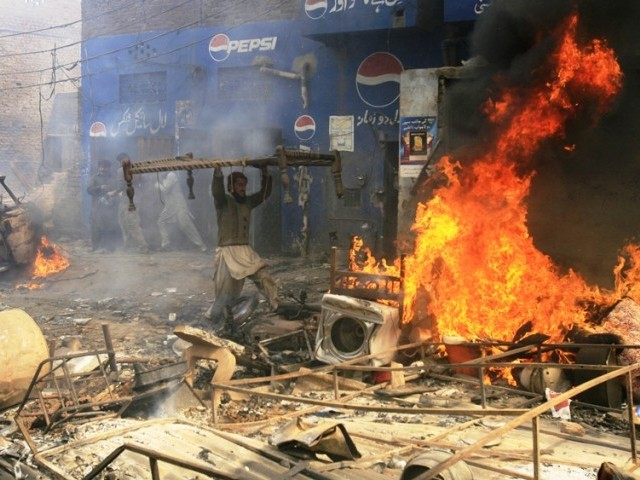 More than 150 houses of Christians living in the Joseph Colony were torched by an angry mob on March 9. PHOTO: REUTERS