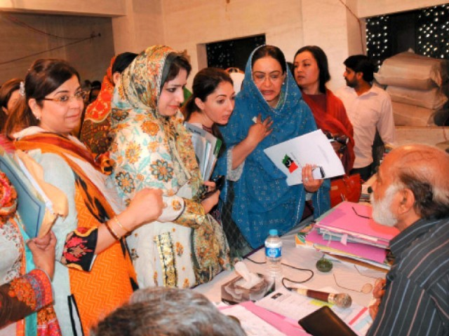 Women aspirants for reserved seats gather at the Sindh Election Commission office where the returning officers will scrutinise their applications. PHOTO: RASHID AJMERI/EXPRESS