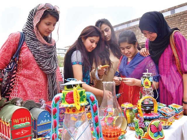 Visitors take keen interest in items put on display at art bazaar. PHOTO: APP