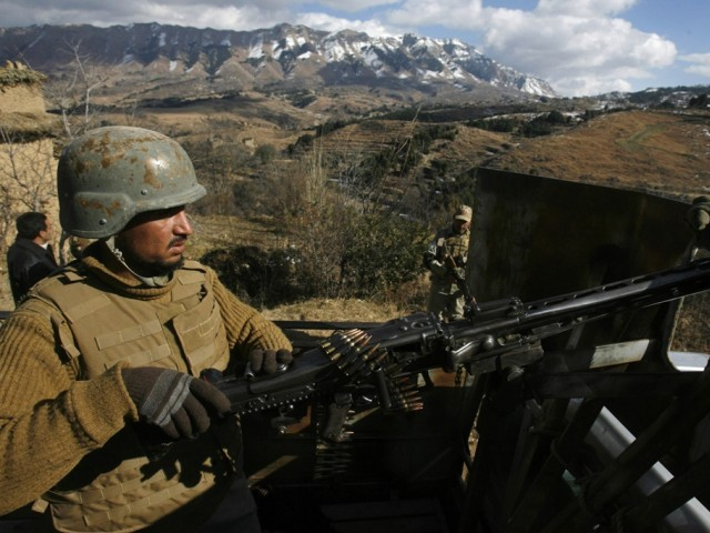 A Pakistani army soldier stands guard  during a patrol in Pakka village in Kurram Tribal Agency December 18, 2012. PHOTO: REUTERS