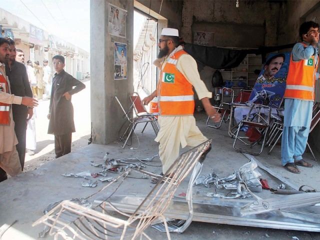 Destruction at the office of independent candidate after a bomb blast in  Peshawar. PHOTO: MUHAMMAD IQBAL/EXPRESS