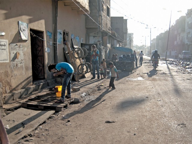Life slowly unfurls on Mehmoodabad road in NA-251 before the day takes over. PHOTO: HALIMA MANSOOR/ EXPRESS/FILE