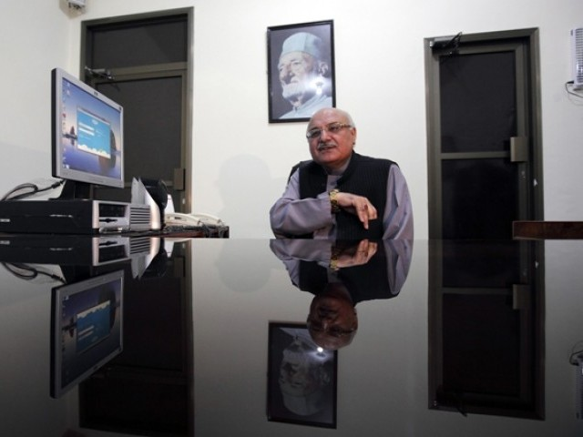 Mian Iftikhar Hussain of the Awami National Party and candidate for the upcoming elections, sits at his desk during an interview with Reuters at his party office in Peshawar, May 1, 2013. PHOTO: REUTERS