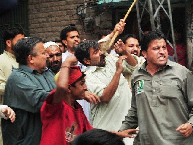 """MQM workers are openly displaying arms and torturing people"" PHOTO: AFP/FILE"