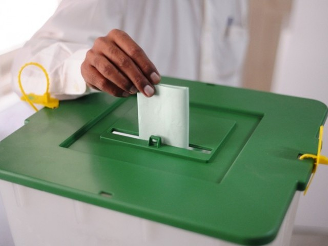 Muhammad Irfan was casting two bogus votes. PHOTO: AFP