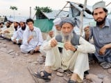 IDps showing their CNIC'c. PHOTO: AFP / PESHAWAR