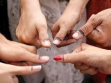 Voters showing their inked thumbs. PHOTO: Ayesha Mir/Express