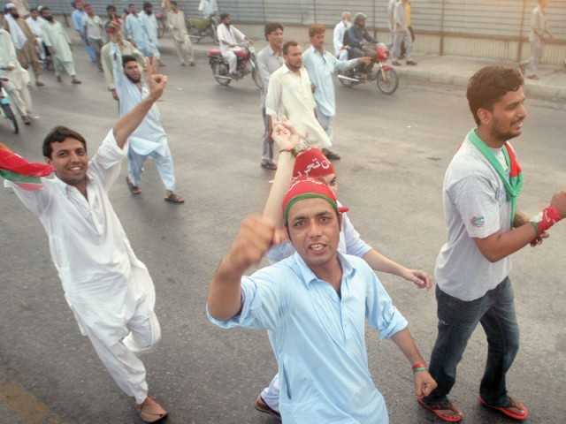 Protesters at the Native Jetty bridge shout slogans against rigging in NA-239. PHOTO: ATHAR KHAN/EXPRESS