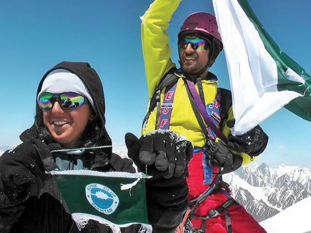 Samina, 21, besides a flagpost on Mount Everest, Nepal. PHOTO: EXPRESS