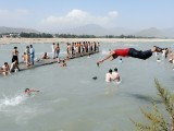 Young men taking a dip in the Swat River. PHOTO: FAZAL KHALIQ