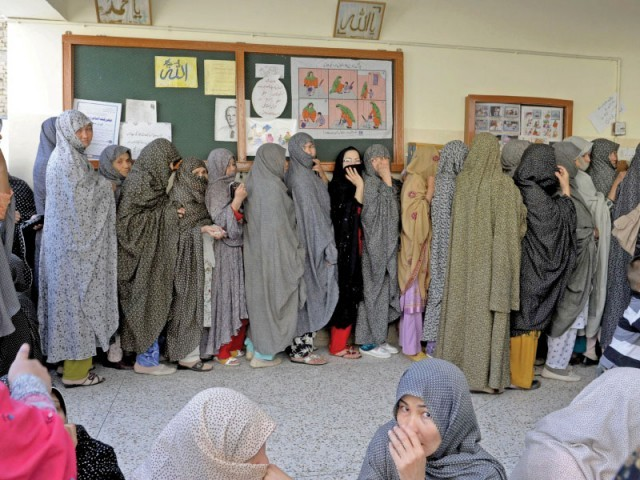 Female voters of the Hazara community line up to cast their votes. PHOTO: AFP