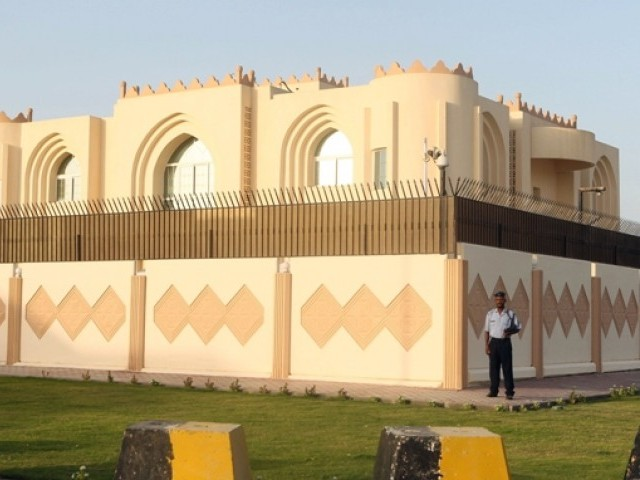 Security guards stand outside the new Taliban political office in Doha before the official opening on June 18, 2013. PHOTO: AFP