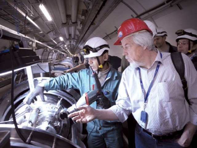 Pakistani engineer Amir Aijaz (left) explains the repair work of the Large Hadron Collider to CERN Director General Rolf-Dieter Heuer at CERN in Geneva. PHOTO COURTESY: DR HAFEEZ HOORANI