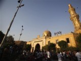 egyptians-stand-outside-el-sayeda-nafisa-mosque-after-funeral-prayers-for-shiite-victims-who-were-killed-in-sectarian-violence-in-cairo