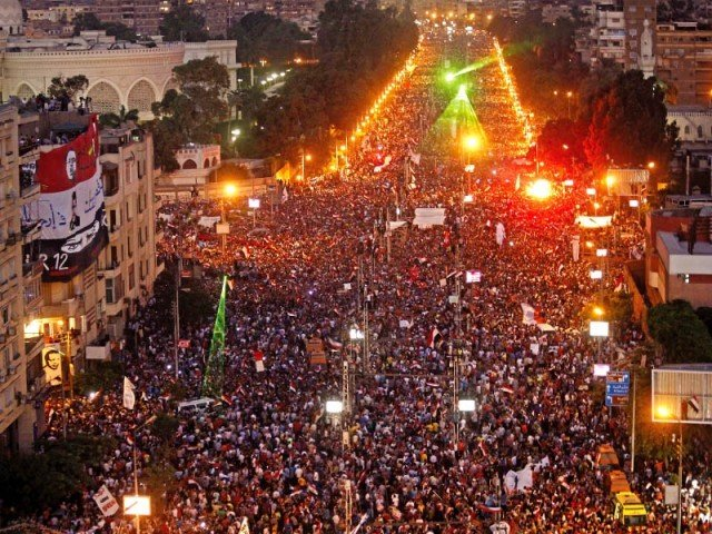 Hundreds of thousands of Egyptian demonstrators gather outside the presidential palace in Cairo. PHOTO: AFP